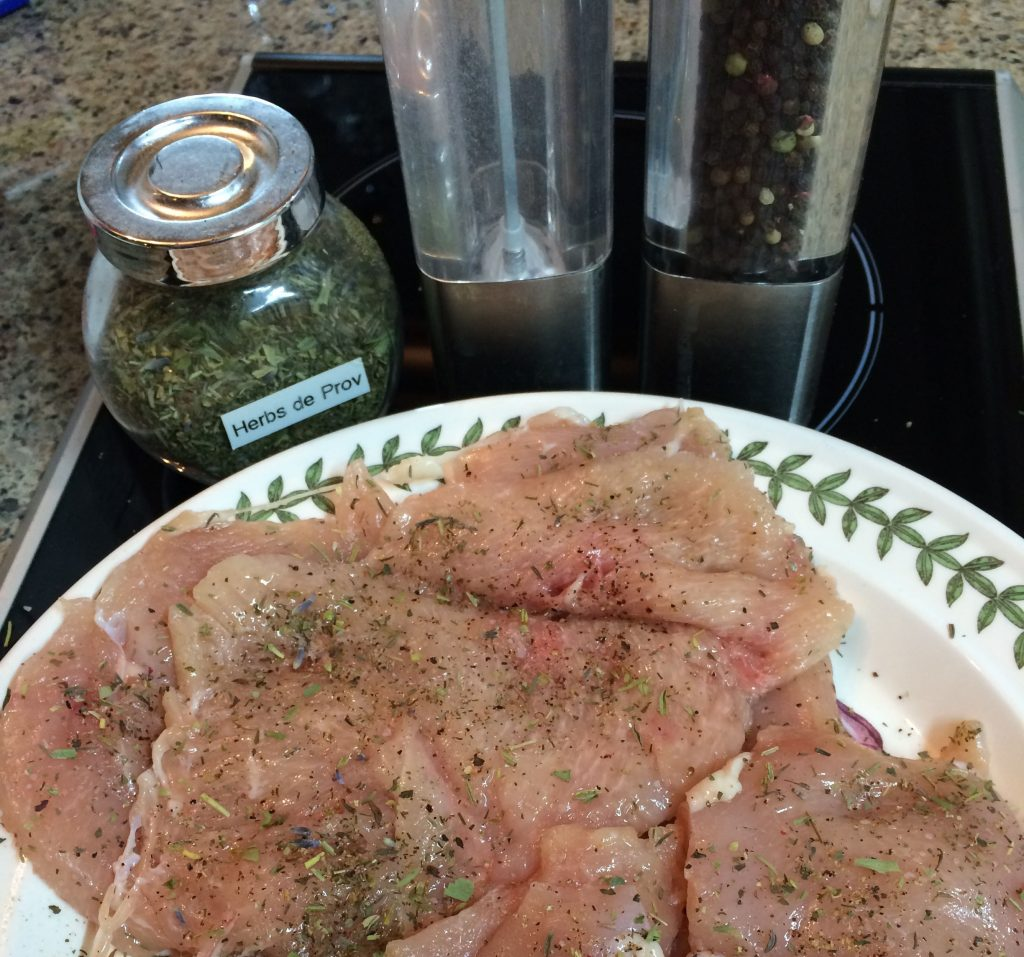 Chicken Katsu - Seasoning the chicken with herbs