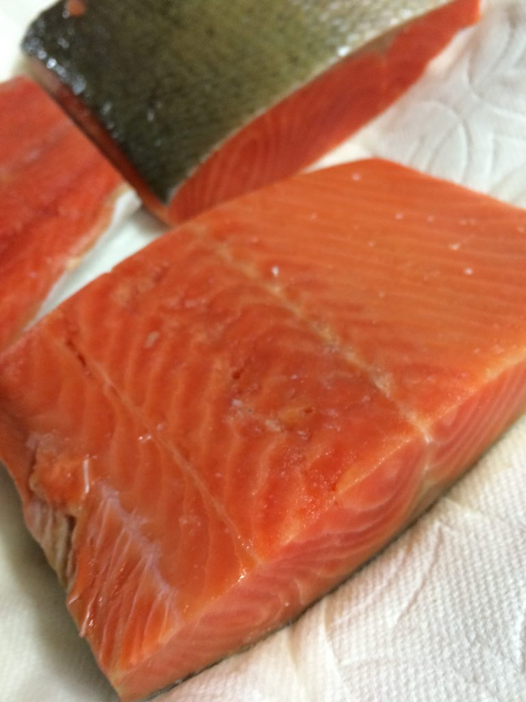 Honey Mustard Salmon - Drying salmon with paper towels