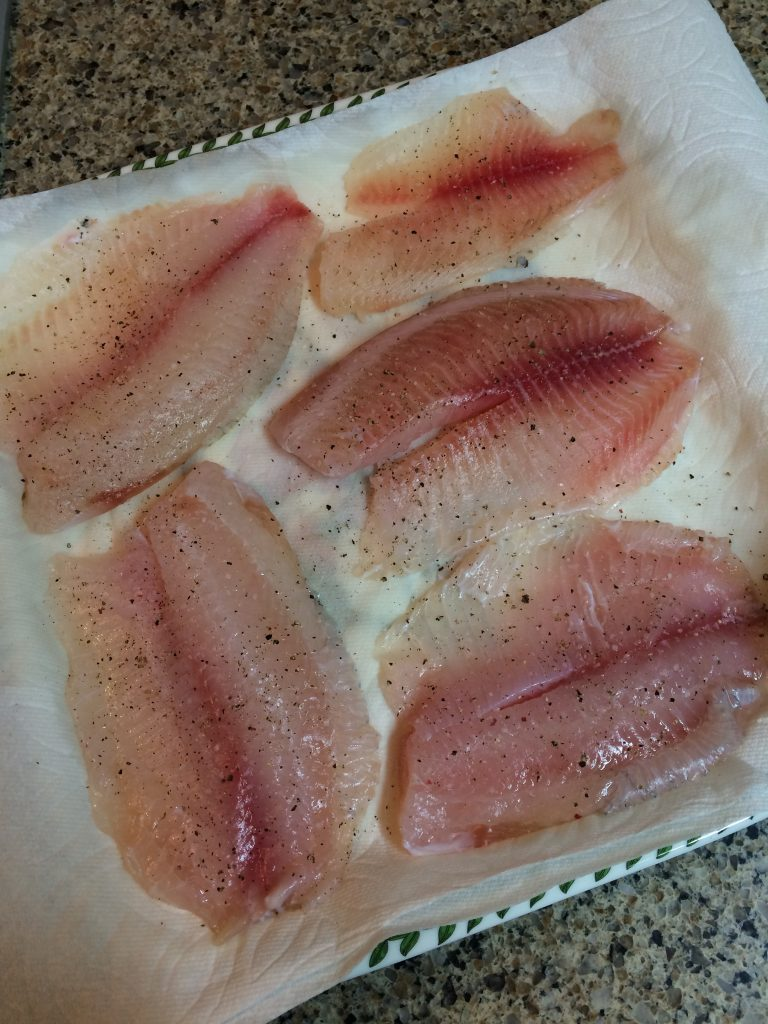 Basil Pesto Tilapia - Seasoning the fish with herbs and spices