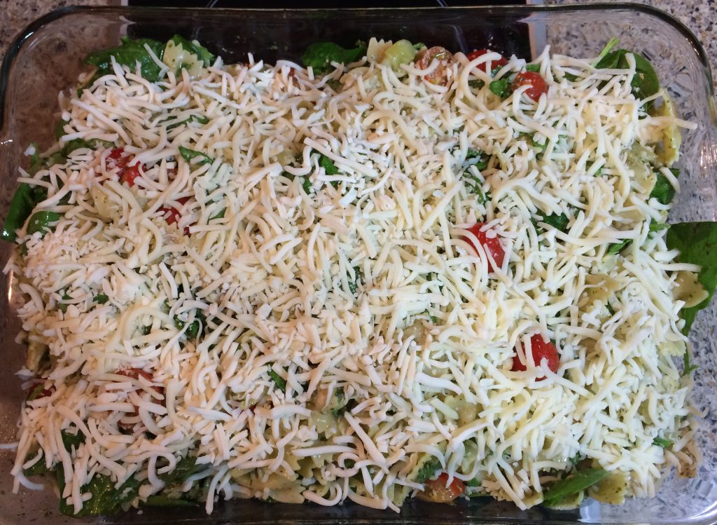 Basil Pesto Chicken Pasta - Topping the pasta with cheese