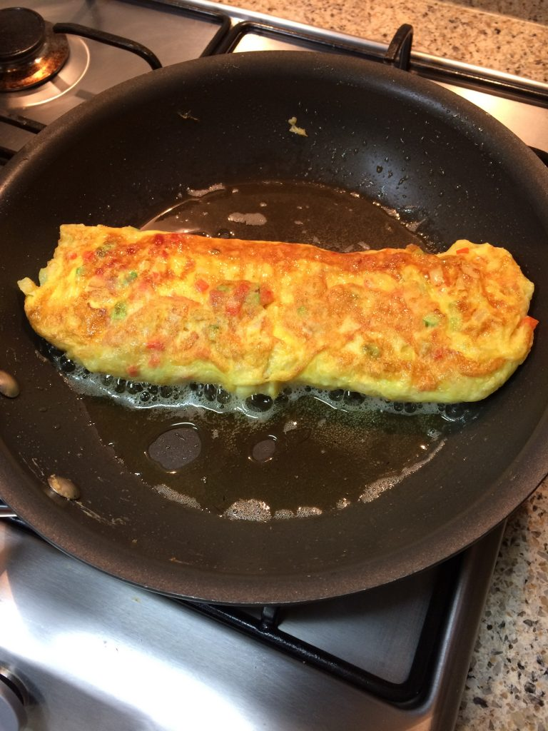 Korean Omelet - Folding and rolling the omelet