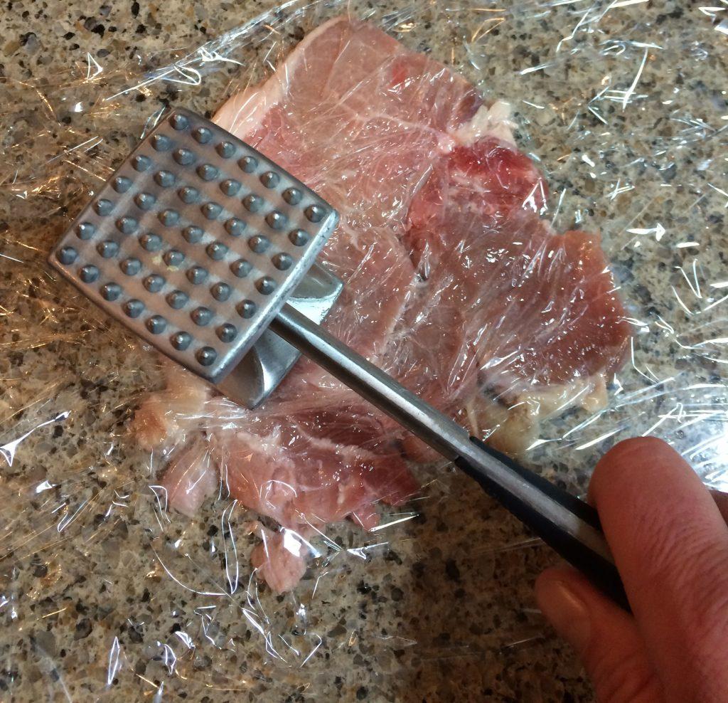 Pork Katsu - Flattening pork with a tenderizer hammer