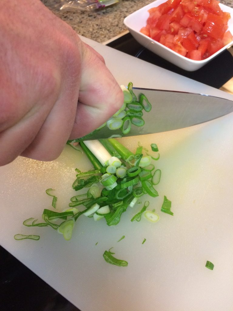 Hawaiian Fish Taco - Slicing onions