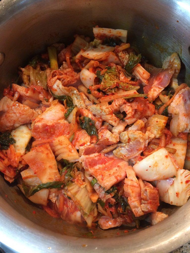 Kimchi Jjigae - Frying kimchi and pork